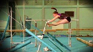 A gymnast on the asymmetric bars