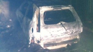 Image for Family cars burnt out by intruders