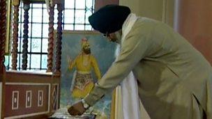 Sikhs praying