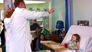 Image for The Singing Doctors visit sick children in hospital in Wrexham, North Wales