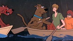 Scooby, Shaggy and Velma in a boat.
