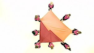 Dancers making shapes with fabric