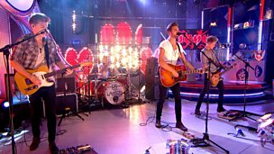 Lawson performing in the studio