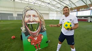 Robbie Savage stands next to a cut out of himself