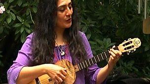 Latin American rhythms on the cuatro