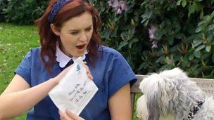 Ashleigh and Pudsey sitting on a bench looking at their fan mail.