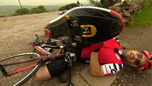 Barney Harwood lying on the ground after falling off his bike