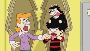 Dennis the Menace and Gnasher playing a prank on a teacher.