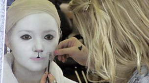 The White Rabbit having her make up applied.