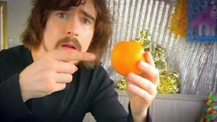 Max Byrne holding an orange.