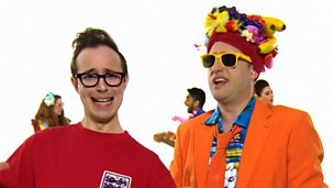 Gary Ogden dressed as an England player and Bob Roberts dressed in bright colours with fruit on his head.
