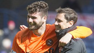 Dundee United manager Jackie McNamara talks to Ian Turner after win against Rangers.