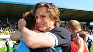 Wycombe manager says avoiding relegation from Football League has saved jobs at the club.