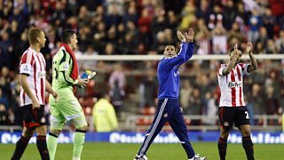 Gus Poyet speaks to Ian Dennis after Sunderland beat West Brom to guarantee their safety.