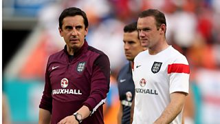 England coach Gary Neville says the country is obsessed with Wayne Rooney.
