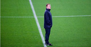 Neil Lennon says that due to depression at the end of game he was just glad it was over.