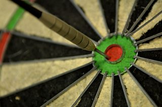 Blind darts player accused of being a benefit cheat after hitting 180 at a charity event.