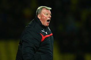 Steve Evans celebrates after Rotherham secure a place in the Championship next season.