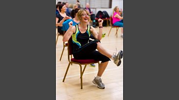 Getting down at Zumba on a chair