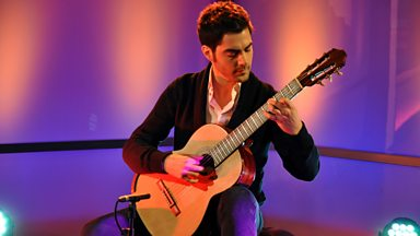 Image for Milos, the award winning classical guitarist explains why he is the happiest person in the world