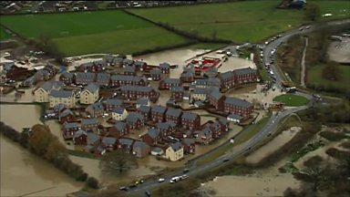 Image for Flooding devastated homes on the Glasdir estate in November last year.