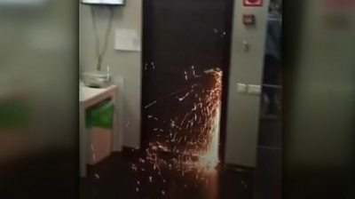 Sparks fly as a door is cut open