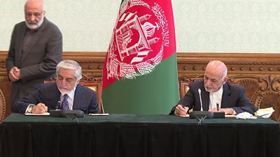 Abdullah Abdullah (seated, left) and President Ashraf Ghani (seated, right) sign a power-sharing deal in Kabul