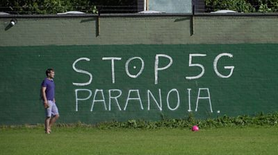 "Wall with ""Stop 5G Paranoia"" graffiti"