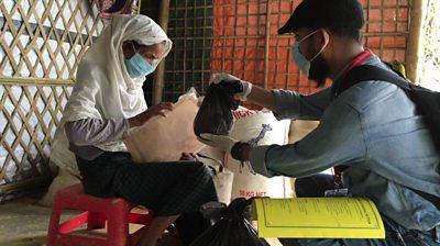 A medical volunteer tends to a refugee