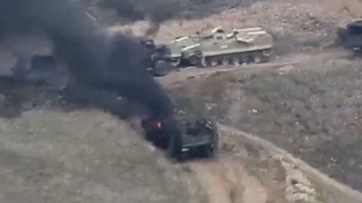 Military vehicles on fire