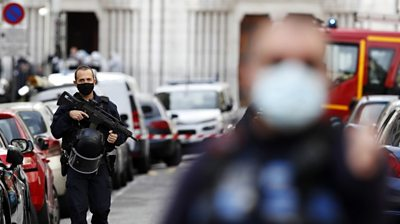 Armed French police officers secure the street near the entrance of the Notre-Dame Basilica church in Nice, France,