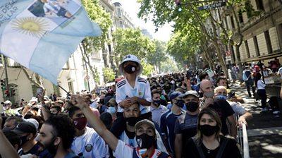 Diego Maradona: Fans weep by football legend's coffin