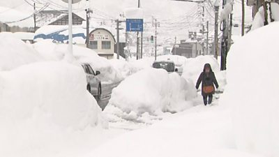 Japan is hit by severe snow storms, killing at least eight and bringing some regions to a standstill.