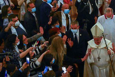 Pope greeted by crowds of people