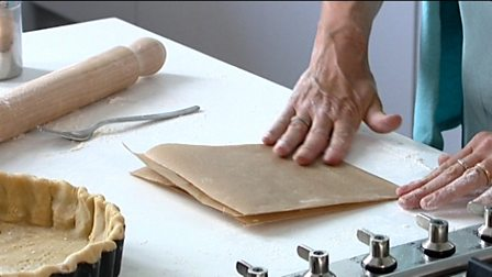 Lining a tart with a cartouche (baking blind)