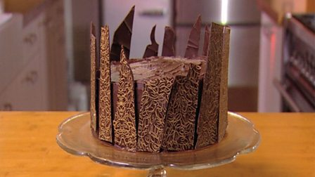 Decorating a cake with chocolate transfer sheets