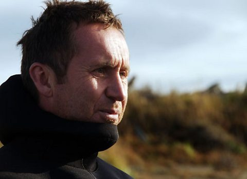Bruce dons a wetsuit to to dive for gold in the freezing sea off Alaska