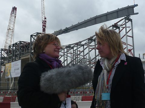 Sheila Dillon and Ros Seal in front of The 2012 Aquatic Centre designed by Zaha Hadid