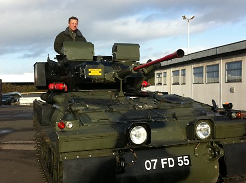 Presenter Francis Tusa in a Scimitar armoured vehicle.