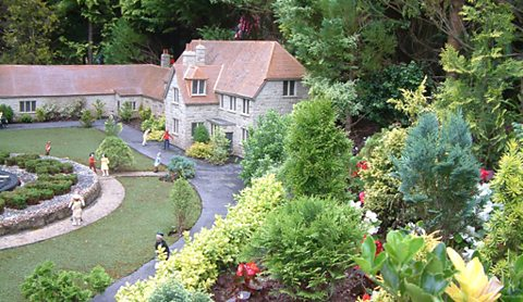 Getting the conifers just so...at Babbacombe Model Village, Torquay