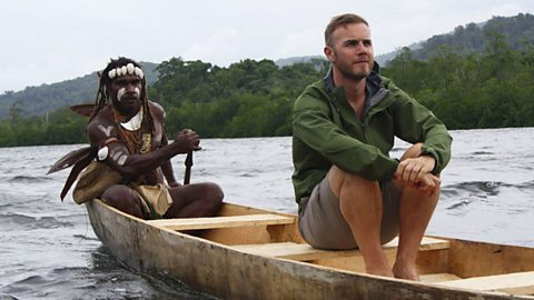 Gary Barlow being rowed by tribesmen in the Solomon Islands