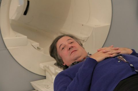 Stephen Fry about to enter an MRI Scan
