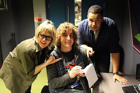 Edith with Matt from The Pigeon Detectives, his notebook, and Mark from Mahogany Blog
