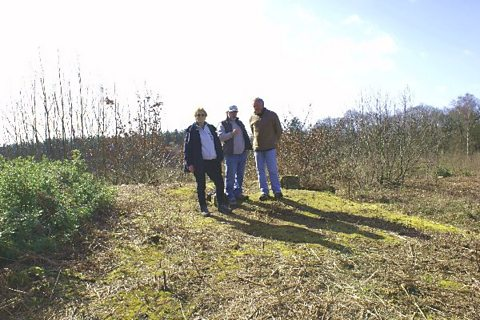 Richard stands on top of Thynghowe with Lynda Mallett and Stuart Reddish
