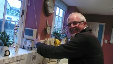 Richard in his kitchen with the Cooker Minder developed by BIME