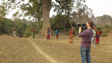 Filming women collecting wood