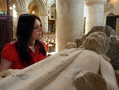 Dr Janina Ramirez at the Malmesbury Abbey with King Athelstan's tomb