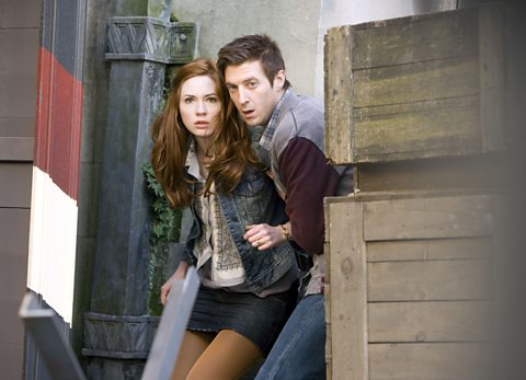 Amy and Rory take a sneaky peek around some crates