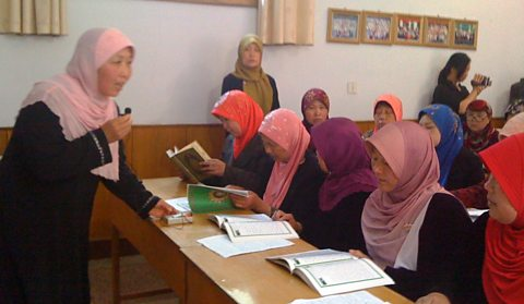 A female imam teaching Arabic at Jiyuan