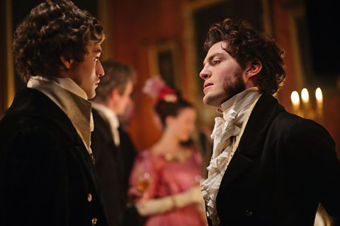 Pip (Douglas Booth) and Bentley Drummle (Tom Burke) at the ball